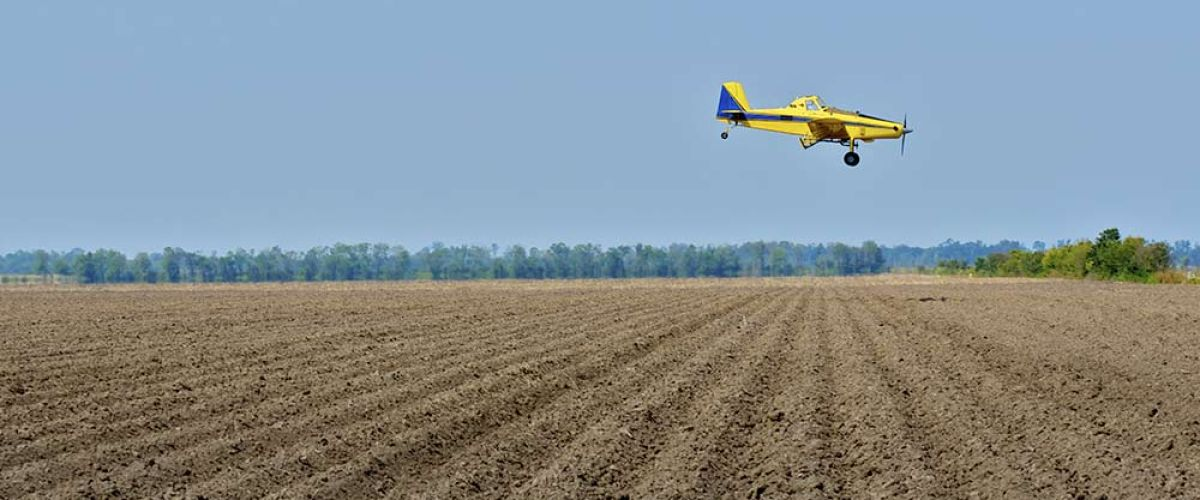 Crop duster spray pesticides
